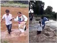 Corona Vaccination in Chhindwara: VIDEO उफनते नाले को पार कर गांव पहुंची टीकाकरण टीम